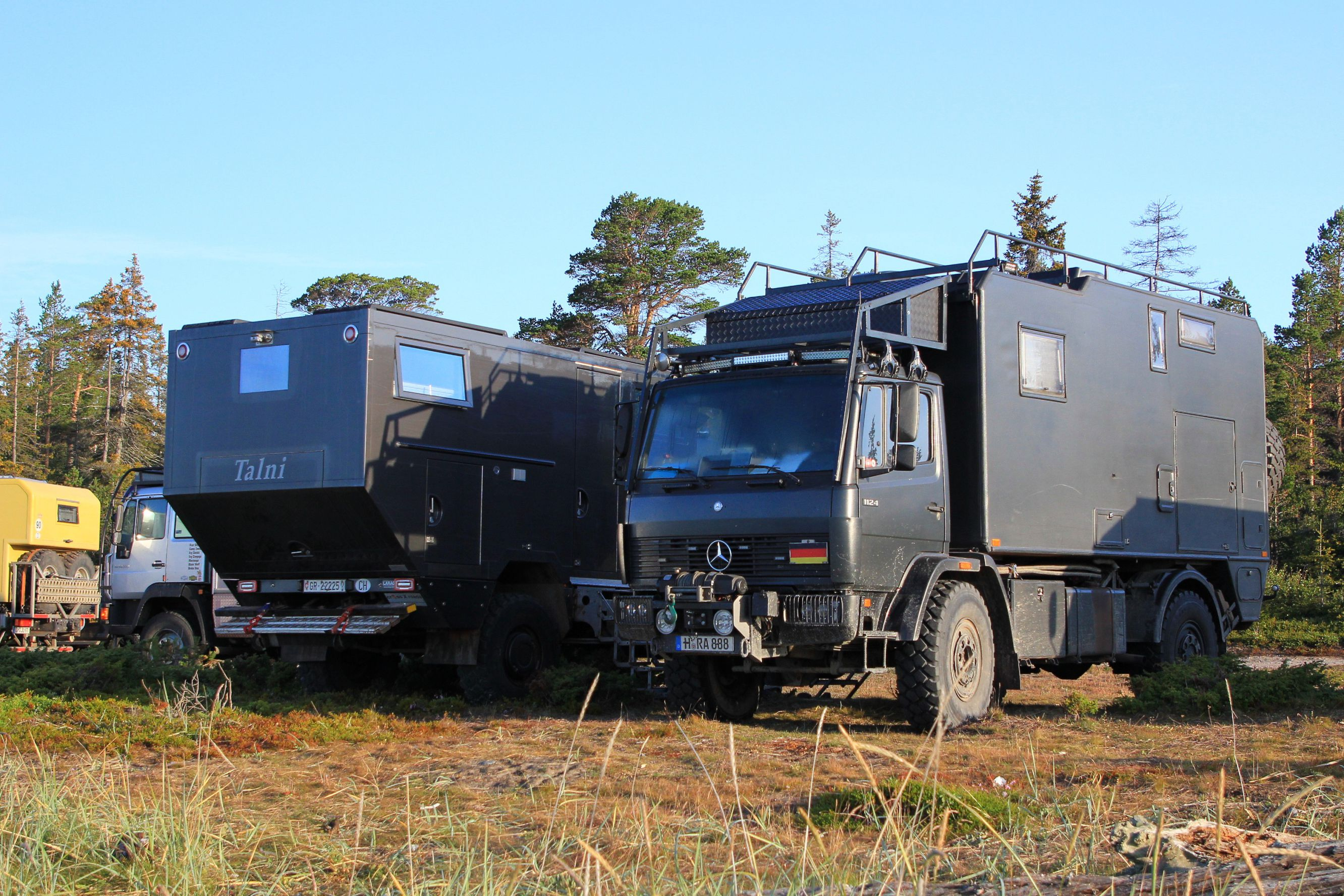 unimog-camper-white-sea-travel
